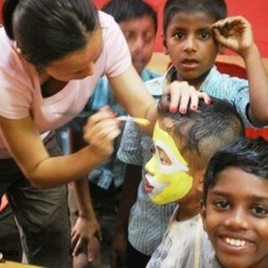 en--IND01-Face-painting-with-orphanage-kids-284x250